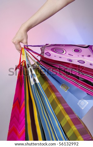 Hand holding shoping bags - stock photo