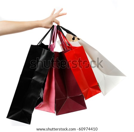 Hand holding shopping bags,isolated on white - stock photo