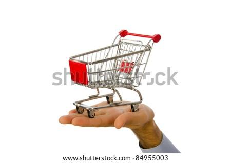 Hand holding shopping cart on white - stock photo