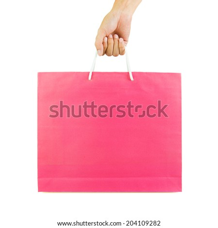 Hand holding shopping paper bag isolated on white background - stock photo