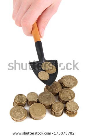 Hand holding shovel with coins isolated on white - stock photo