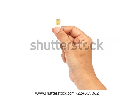 Hand holding sim card and put into smartphone isolated on white background - stock photo