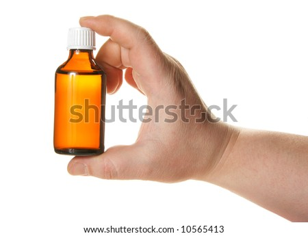 Hand holding small bottle with drug isolated over white background - stock photo