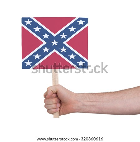Hand holding small card, isolated on white - Flag of the Confederacy - stock photo