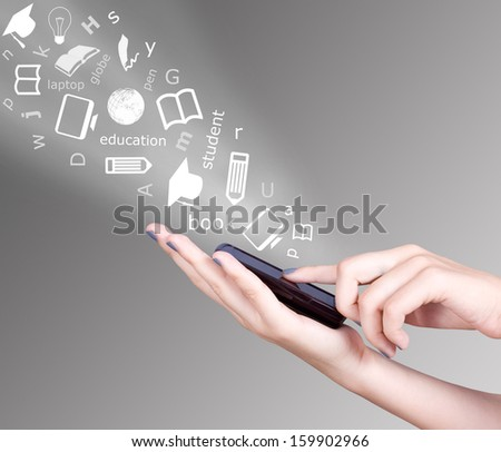 Hand holding smart mobile phone and education symbols flying away, Education concept