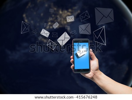 Hand holding smart phone e mail stock photo 415676248 shutterstock hand holding smart phone with e mail icon and earth cool tone backgrounde mail voltagebd Choice Image