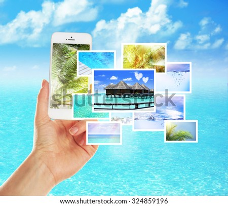 Hand holding smart phone with streaming images - stock photo