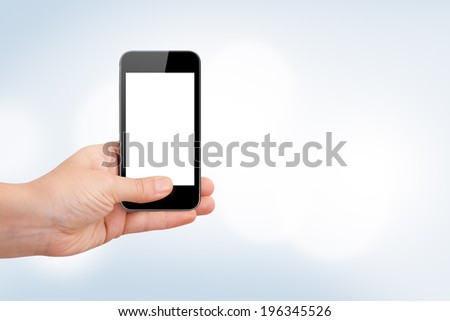 Hand holding smart phone with white blank screen for your design on blurry blue background. - stock photo