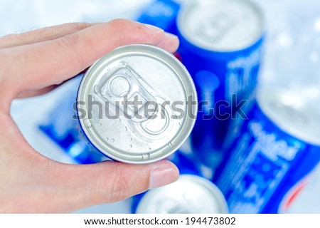 Hand holding soda can - stock photo