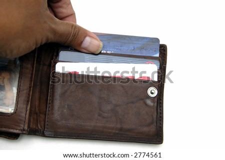 Hand holding some credit card in a wallet - stock photo