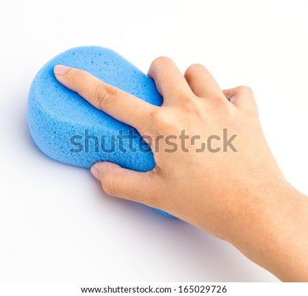 Hand holding sponge on isolated white background - stock photo