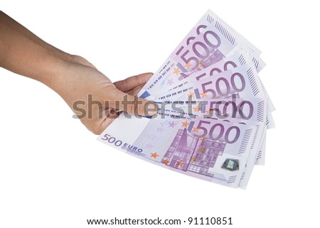 Hand holding stack of 500 Euro banknotes. Euro banknotes in hand isolated on white. - stock photo