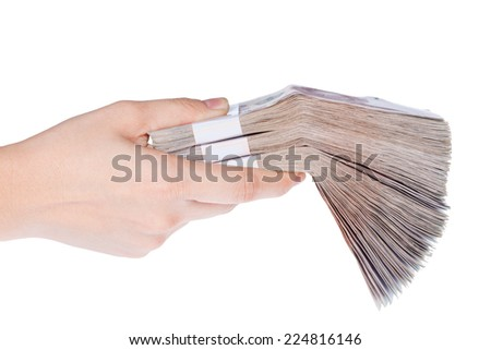 Hand holding stacks of banknotes ,Isolated on white background - stock photo
