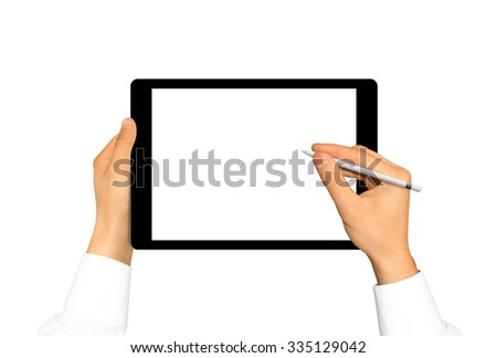 Hand holding stylus near graphic tablet blank screen. Empty tab display mock up isolated. Designer drawing, painting, sketching. New digitizer pencil presentation. Black tablet touchscreen mockup. - stock photo