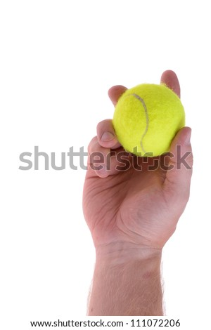 hand holding tennis ball ready to serve - stock photo