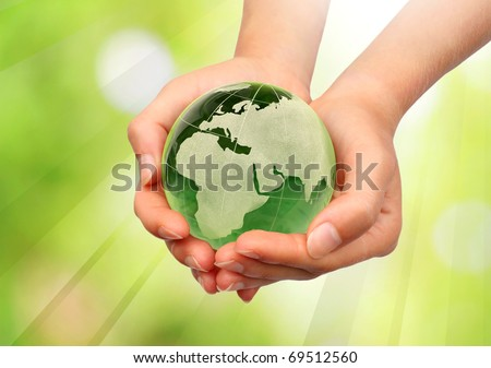 Hand holding the Earth - stock photo