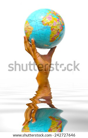 hand holding the globe on water reflection - stock photo