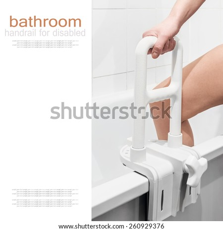 hand holding the handrail in the bathroom. Focus on the handrail. text is an example of writing and can be easily removed  - stock photo