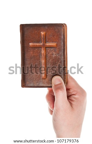 Hand holding the old bible isolated on white - stock photo