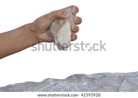 Hand holding the stone