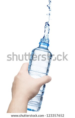 Hand holding the water bottle with water splash - stock photo