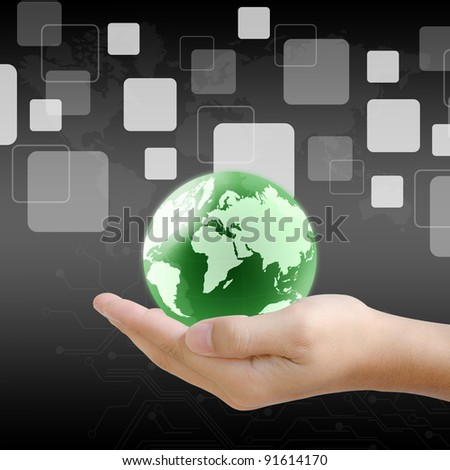 hand holding the world and buttons - stock photo