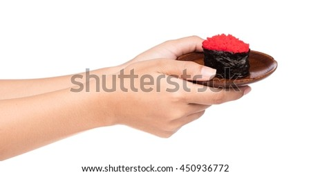 hand holding Tobiko roe sushi fish egg in plate isolated on white background
