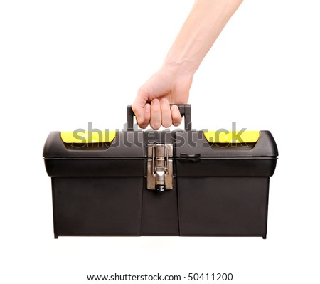 hand holding toolbox isolated on white, carpenter. - stock photo