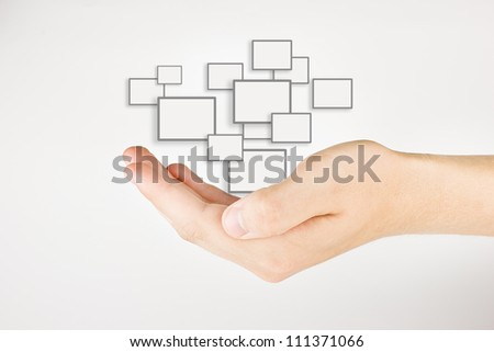 hand holding touch screens on gray background - stock photo