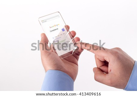 Hand Holding Transparent Smartphone with Compliance screen