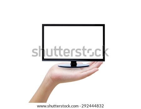 Hand holding tv on white background - stock photo