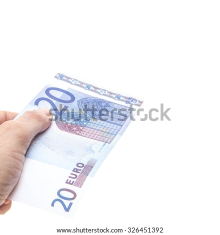 Hand holding twenty euro note. All on white background.