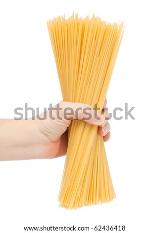 Hand holding uncooked spaghetti bolognaise - stock photo