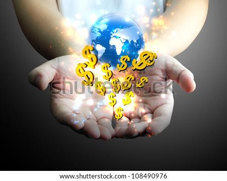 hand holding US dollar with world - stock photo