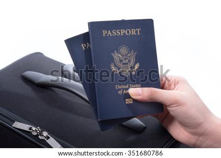 Hand holding US passport - stock photo