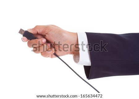 Hand holding USB cable  - stock photo
