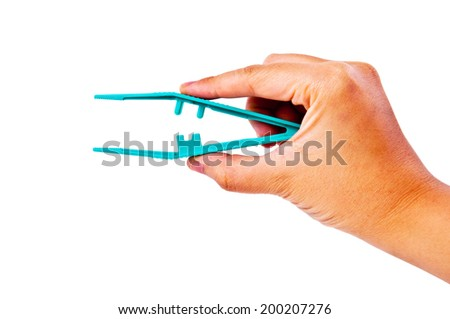 Hand Holding Using Tweezers Medical Tool and Surgery Instrument, Isolated on white background. - stock photo