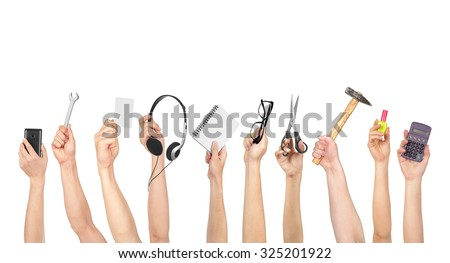 Hand holding various objects isolated on white background - stock photo