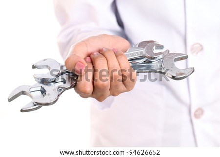 Hand holding various size spanners- Helping Hand