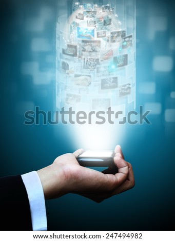 Hand holding virtual phone - stock photo
