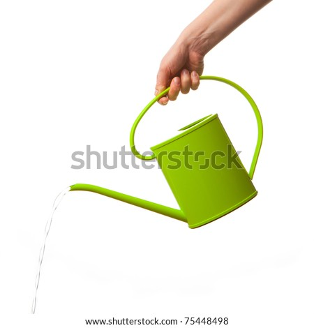 hand holding watering can isolated - stock photo