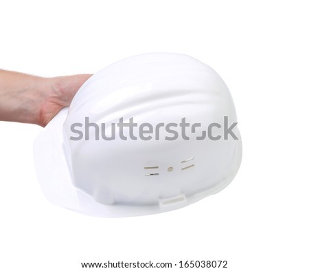 Hand holding white hard hat. Isolated on white background.