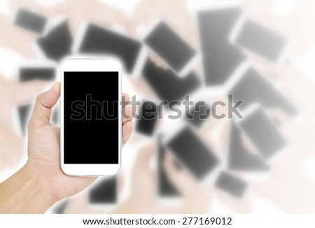 Hand holding White Smartphone with blank screen - stock photo