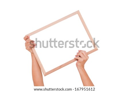 Hand holding whiteboard isolated in white with using path  - stock photo