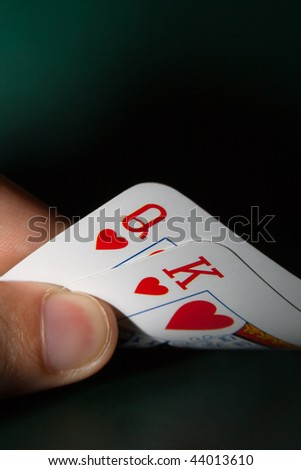Hand holding winning cards - stock photo