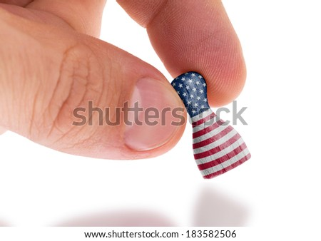 Hand holding wooden pawn with a flag painting, selective focus, United States of America - stock photo