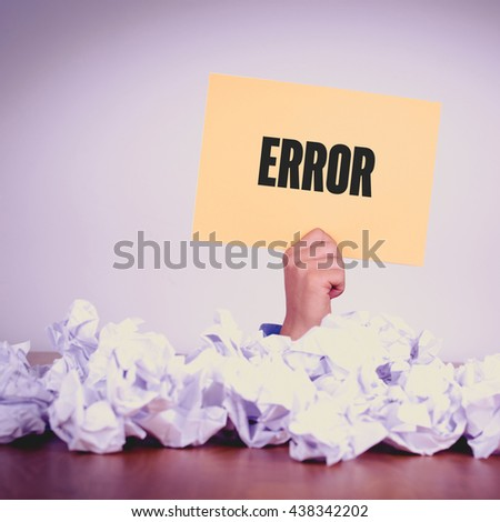 HAND HOLDING YELLOW PAPER WITH ERROR CONCEPT - stock photo