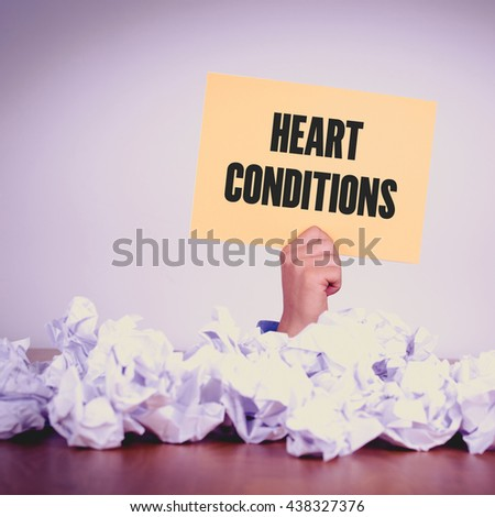 HAND HOLDING YELLOW PAPER WITH HEART CONDITIONS CONCEPT - stock photo