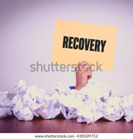HAND HOLDING YELLOW PAPER WITH RECOVERYCONCEPT - stock photo