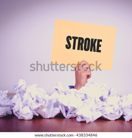 HAND HOLDING YELLOW PAPER WITH STROKE CONCEPT - stock photo